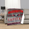 A blanket throw reversible to sherpa with the Washington Capitals logo