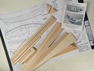 kit contents including plans, wood, and instructions