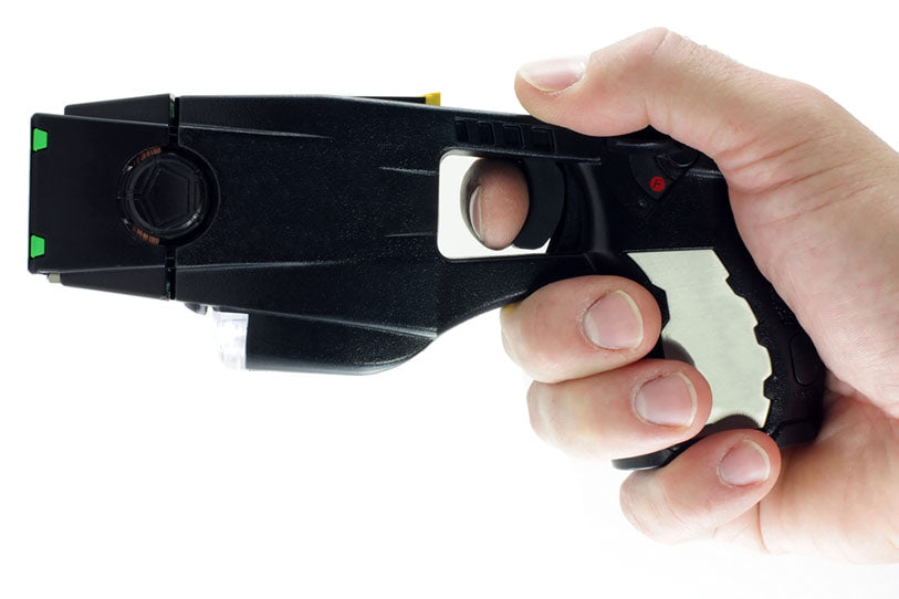 common police taser in hand