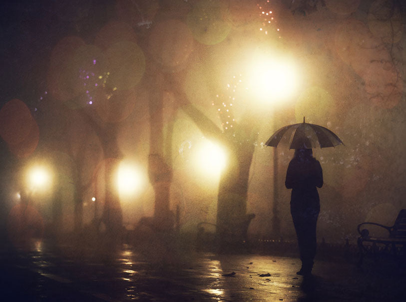 Single girl with umbrella at night alley
