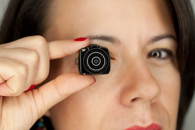 Woman with mini dslr photocamera