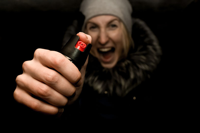 screaming woman holding pepper spray