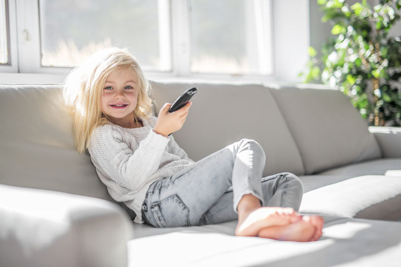smiling girl with remote controller