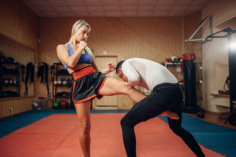 woman kickboxing with partner