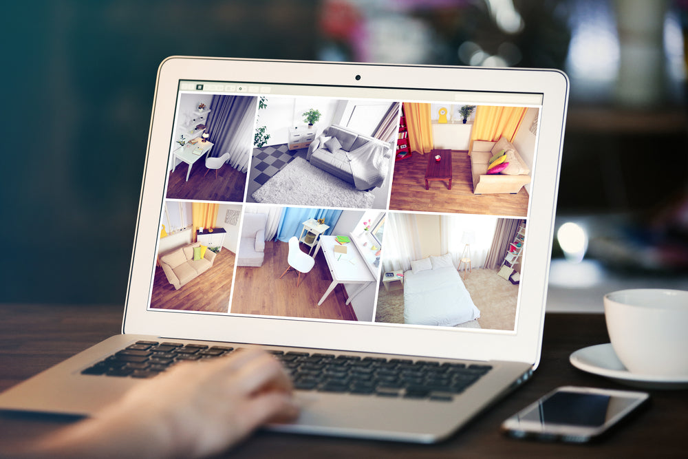 woman monitoring home security cameras