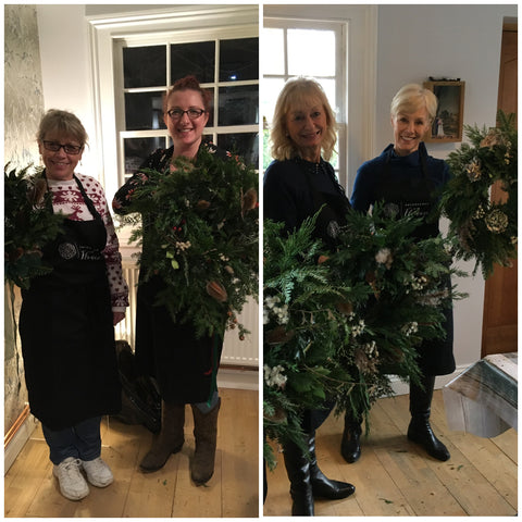 Happy workshop attendees with their festive wreaths