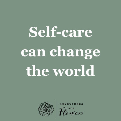 light green square with white writing saying self-care can change the world
