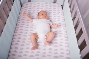 Baby in Cot with Blue SafeDreams 4 Sided Hypoallergenic Cot Bumper