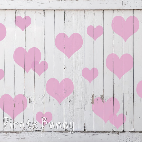 Pink Hearts on a Wooden Fence