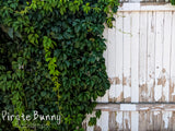 White Wooden Fence with Greenery