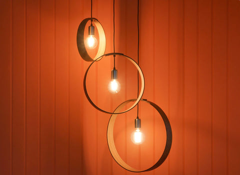 globe light bulbs in wooden pendant set
