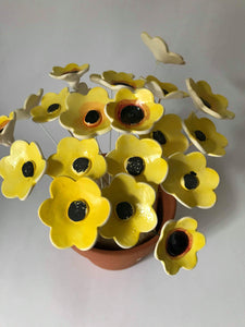 Yellow Ceramic Flowers by Ingrid Russell