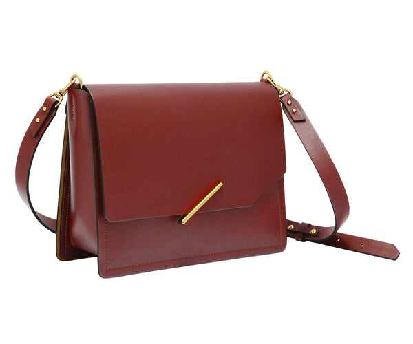 Novae Res Jemison Major Leather Handbag made with Red Leather and Gold Hardware with Crossbody Strap Profile View