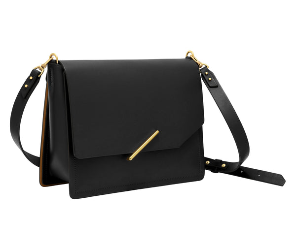 Novae Res Jemison Major Leather Handbag made with Black Leather and Gold Hardware with Crossbody Strap Profile View