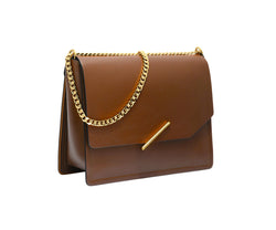 Novae Res Jemison Major Leather Handbag made with Brown Leather and Gold Hardware with Chain Strap Profile View