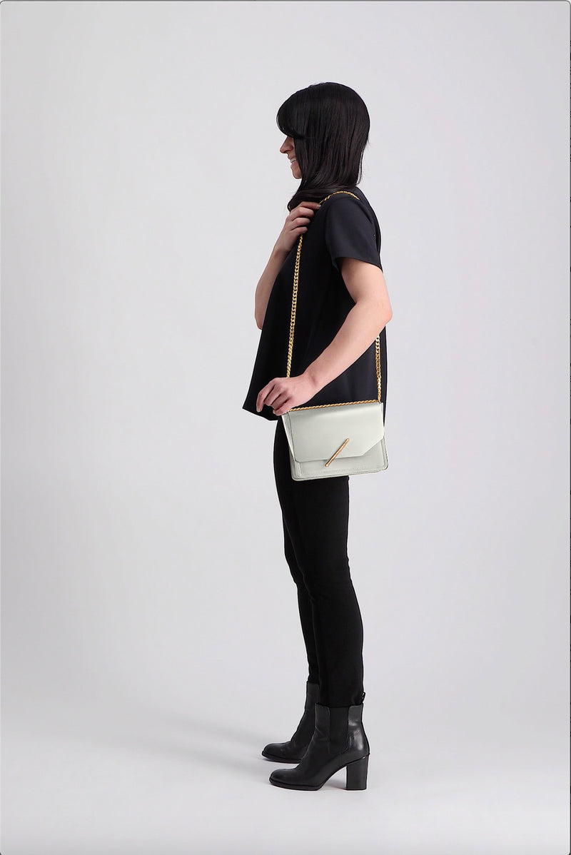 Novae Res Jemison Minor Leather Handbag made with White Leather and Gold Hardware with Chain Strap On Model