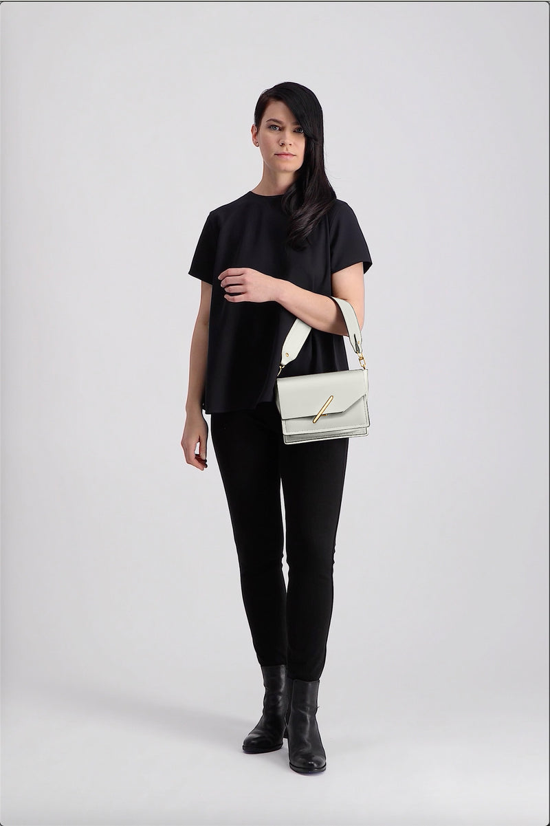 Novae Res Jemison Minor Leather Handbag made in White Leather and Gold Hardware with Short Strap On Model