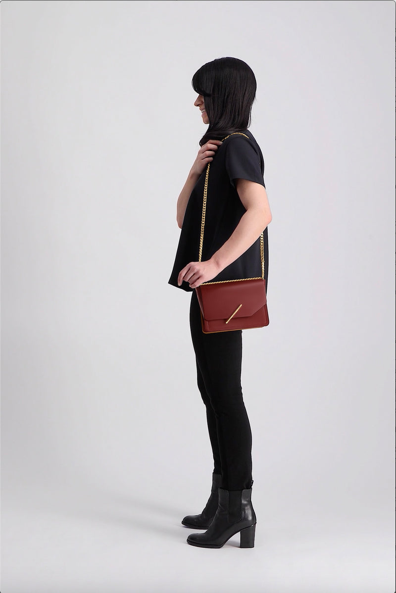 Novae Res Jemison Minor Leather Handbag made with Red Leather and Gold Hardware with Chain Strap On Model