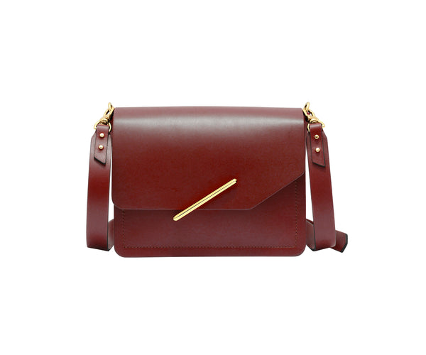 Novae Res Jemison Minor Leather Handbag made in Red Leather and Gold Hardware with Crossbody Strap Front View