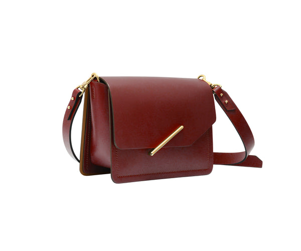 Novae Res Jemison Minor Leather Handbag made in Red Leather and Gold Hardware with Crossbody Strap Profile View