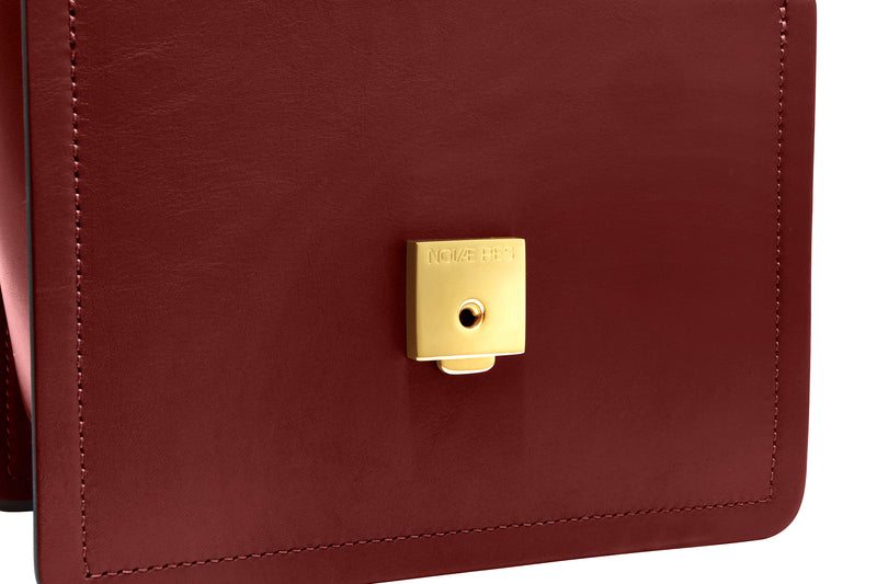 Novae Res Jemison Minor Leather Handbag made in Red Leather and Gold Hardware with Short Strap Inside Lock  View