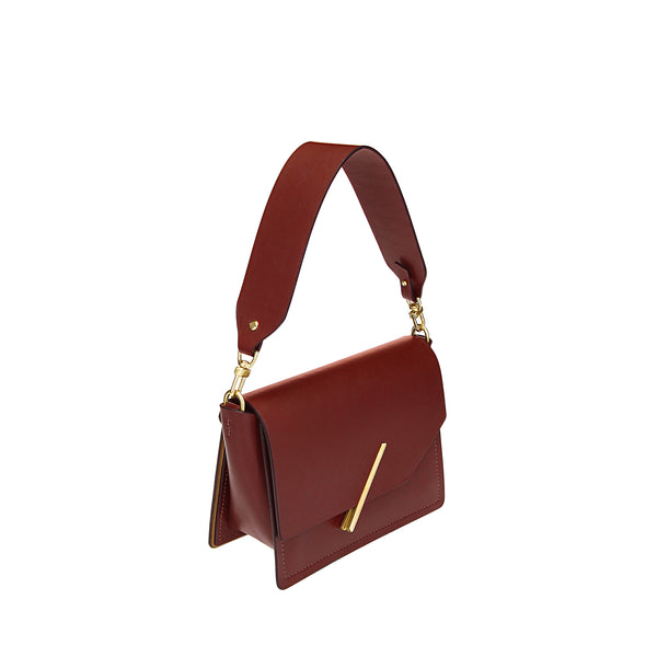 Novae Res Jemison Minor Leather Handbag made in Red Leather and Gold Hardware with Short Strap Profile View