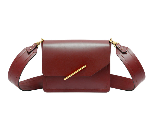 Novae Res Jemison Minor Leather Handbag made in Red Leather and Gold Hardware with Wide Long Strap Front View