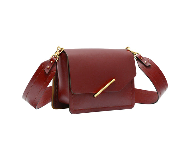 Novae Res Jemison Minor Leather Handbag made in Red Leather and Gold Hardware with Wide Long Strap Profile View