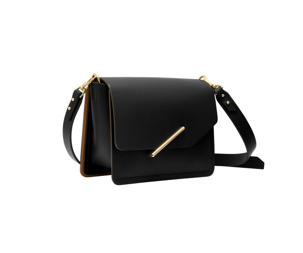 Novae Res Jemison Minor Leather Handbag made in Black Leather and Gold Hardware with Crossbody Strap Profile View
