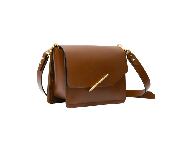 Novae Res Jemison Minor Leather Handbag made in Brown Leather and Gold Hardware with Crossbody Strap Profile View