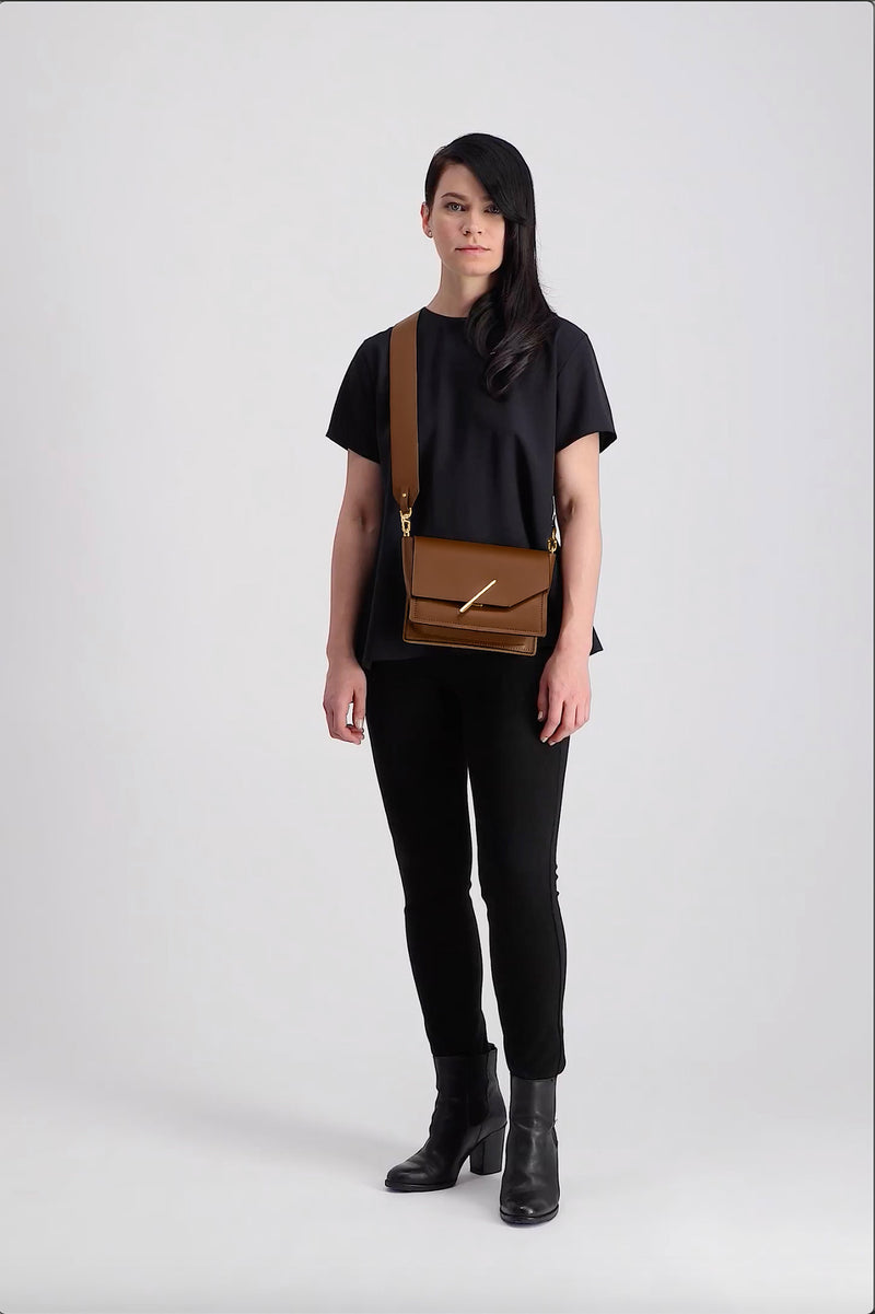 Novae Res Jemison Minor Leather Handbag made with Brown Leather and Gold Hardware with Wide Long Strap On Model