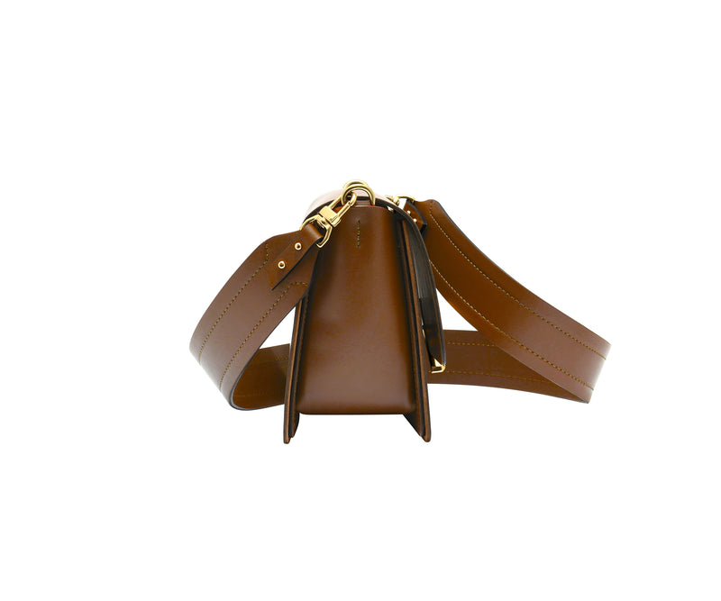 Novae Res Jemison Minor Leather Handbag made in Brown Leather and Gold Hardware with Wide Long Strap Side View