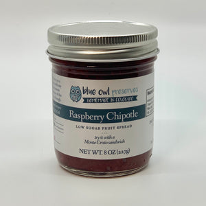 deep red raspberry chipotle jam in jar with blue owl label