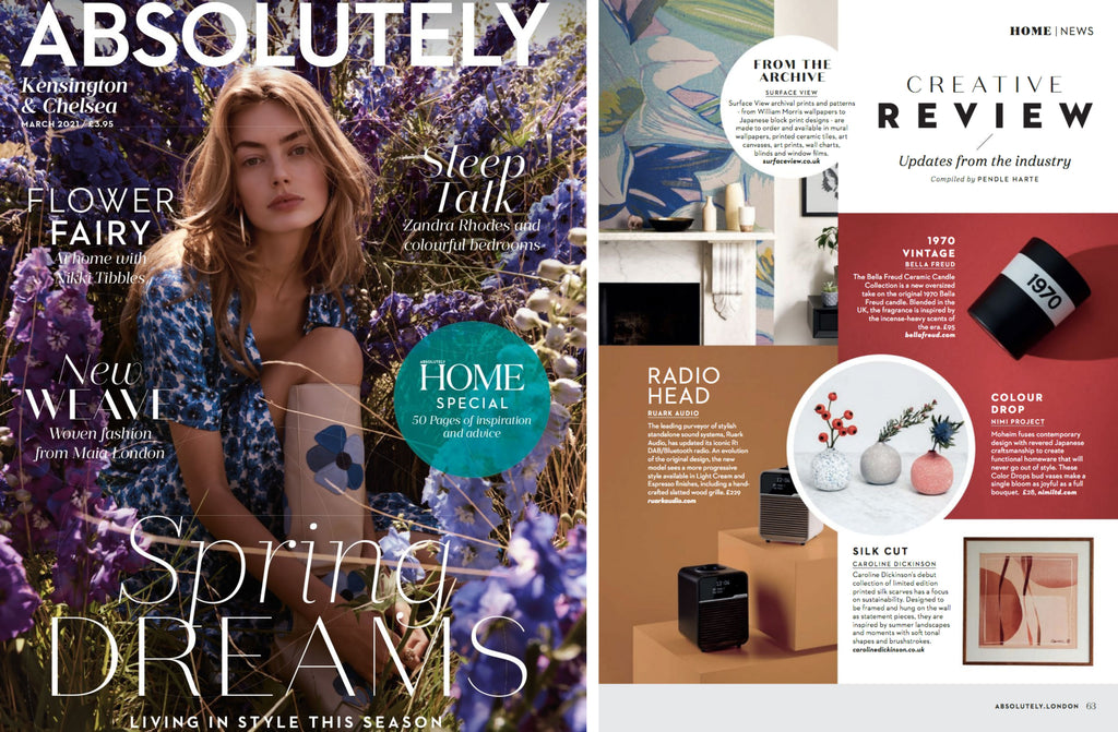 NiMi Projects Moheim Color Drops Vase, three bud vases — white speckled with blue, grey speckled with white, and red speckled with white —  featured in the center of a spread of Absolutely London Magazine