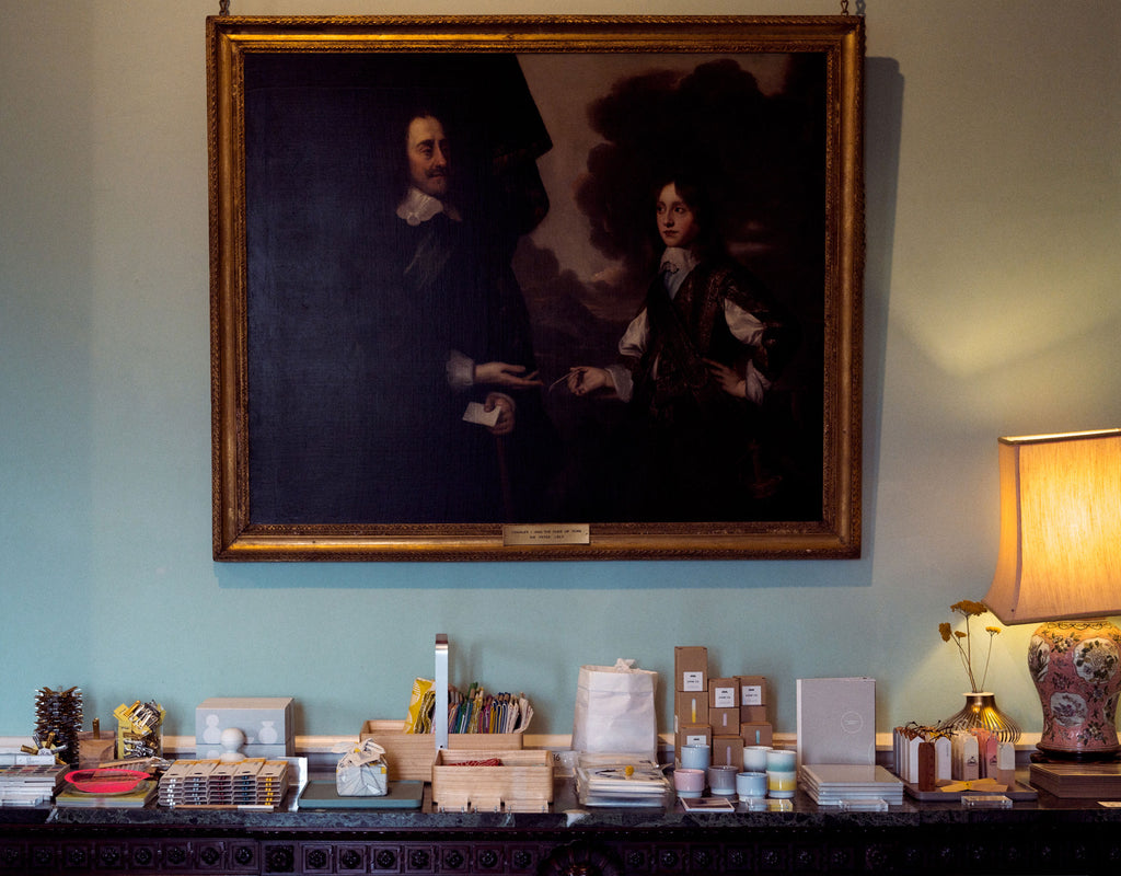 NiMi Projects contemporary Japanese homeware on display on an antique table below a 19th-century painting at Chiddingstone Castle, Kent.