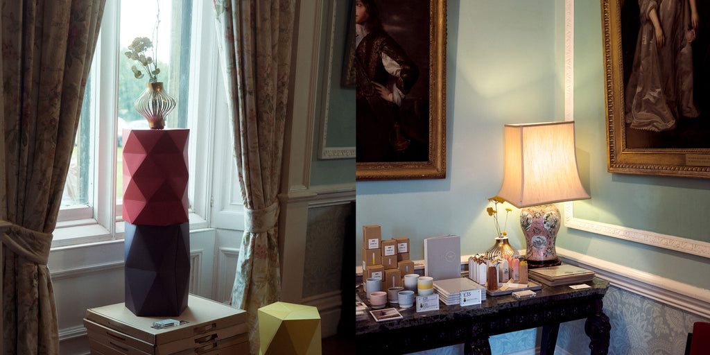 Composite of two images. Left: A Fukunaga paper vase with flowers on top of a red Catachi Polystool stacked on top of a blue Catachi stool, on display in front of a window in Chiddingstone Castle. Right: NiMi Projects Japanese homeware  on display on an antique table, with 19th-century paintings above, at Chiddingstone Castle.