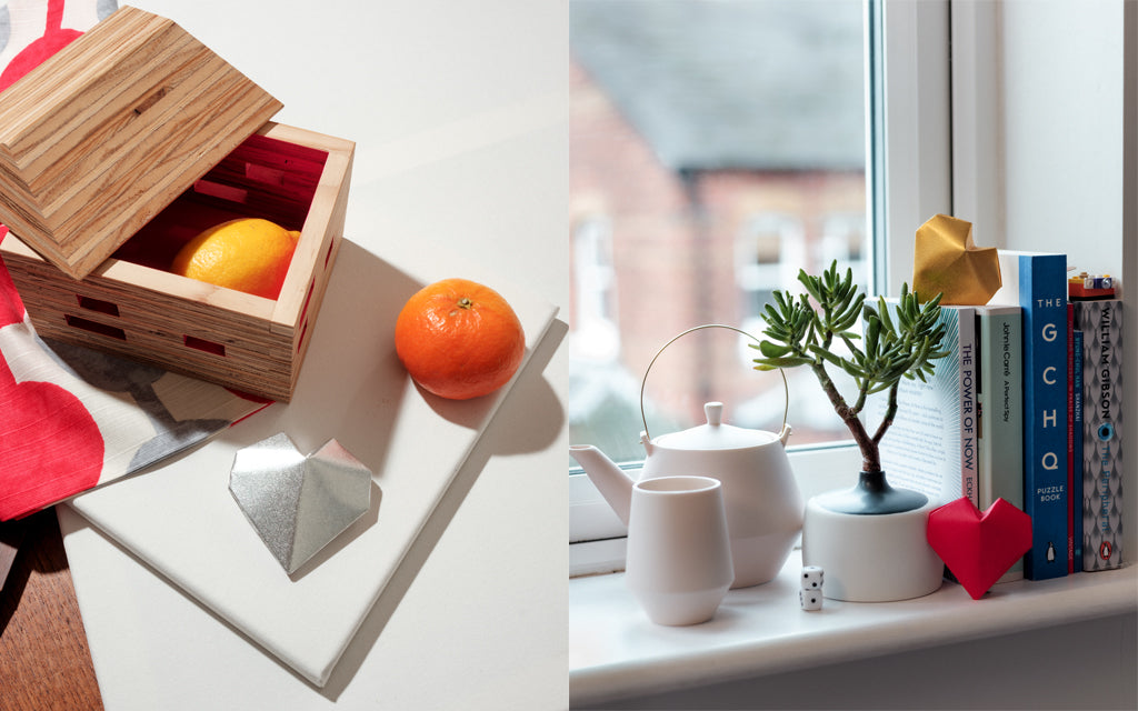 A composite image of two photographs: Left show an open recycled wood Pivoto House Box with pink interior, Right shows a pale pink Frustum Teapot with matching cups on a window sill accompanied by a Watanabe Thoki Vase. All items are handmade. Photographs shot at NiMi Projects UK.