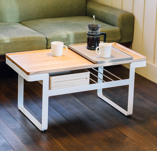 Atelier Yocto's modular Tray Table is a versatile coffee table, with a removable wooden tabletop on which Atelier Yocto serving trays slot perfectly. Available at NiMi Projects, UK.