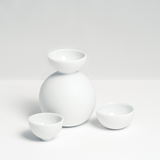 Ceramic Japan's white, matt porcelain Snowman Sake bottle and two small hemisphere cups, designed by Kaichiro Yamada, made in Seto, Japan, and sold at NiMi Projects UK