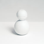 The Snowman Sake set, designed by Kaichiro Yamada for Ceramic Japan, is made of white porcelain and features a rotund bottle with two hemisphere sake cups that fit on top to create the snowman's head. Made in Seto, and photographed at NiMi Projects UK