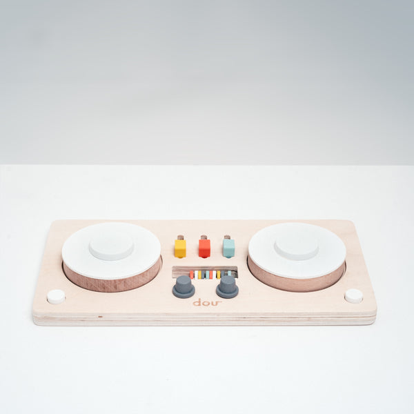 Dou? Little DJ wooden toy decks with moving parts that make different sounds. Designed in Japan