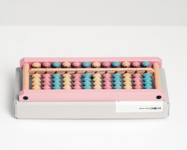 Japanese wooden abacus with pastel coloured beads, designed by Shinya Kobayashi and hand crafted in Japan by soroban artisans Daiichi. Available at NiMi Projects, UK.