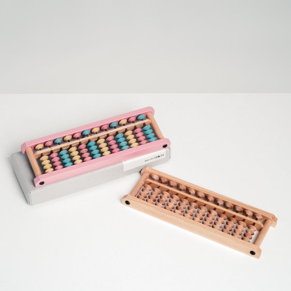 Soroban wooden abacus with pastel beads and natural wood beads, made in Japan by Daiichi. Available at NiMi Projects, UK.