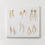 Six pairs of costume pearl and gold earrings, each different and all handmade by OMI from recycled vintage jewelry parts and deadstock sourced in Japan.  Sold at NiMi Projects UK