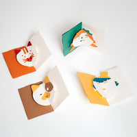 The Face Pop Up Card is so much fun! It's not just a cute greeting card, it's a craft project, a gift and a delightful keepsake. Each design — Cat, Dog, Girl and Boy — is a kit of colourful sheets of pre-cut paper, and available at NiMi Projects