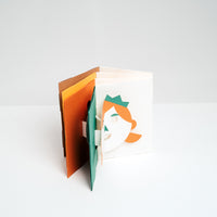 Fukunaga paper Face Popup Cards, designed by Yasuyuki Wada, in brown, yellow, orange and green, made in Japan and available at NiMi Projects UK