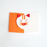 Fukunaga's Cat Face Popup Card featuring an orange tabby cat with eyes and mouth that move when the card is opened. Made in Japan, this card comes as a kit of precut paper parts and is available at NiMi Projects UK.