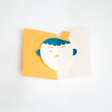 The Boy Face Popup Card, designed by Yasuyuki Wada, features a green-haired lad wearing a yellow hat, against a yellow background. Open it up and his eyes and mouth move! This card comes as a DIY kit of pre-cut paper, made in Japan and available in the UK at NiMi Projects.