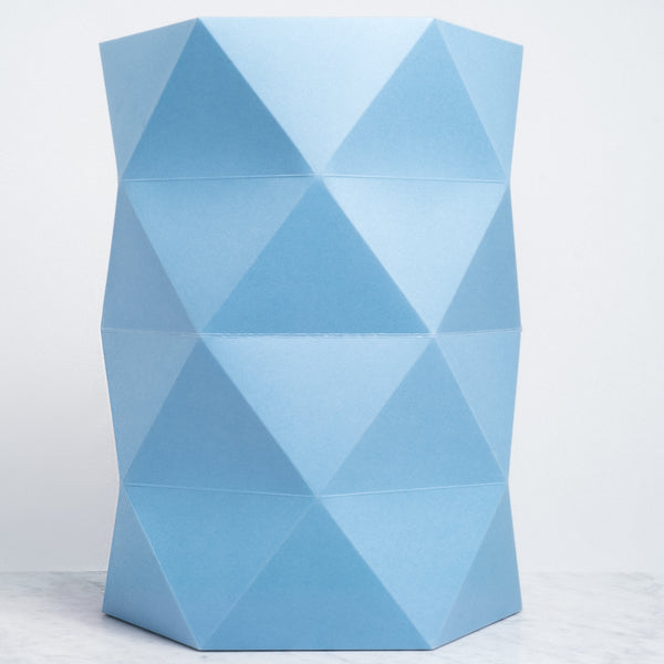 A pale blue faceted Catachi 6x4 polygonal paper and cardboard stool inspired by origami folds and designed by Catachi. Made in Japan and available at NiMi Projects UK.