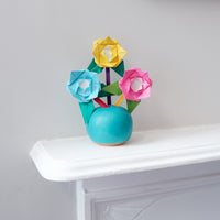 Make Mum a bouquet of colorful origami roses with vibrant green leaves. Set on little sticks, these are blooms that she can pop into a vase and admire forever.  Only at NiMi Projects Sevenoaks